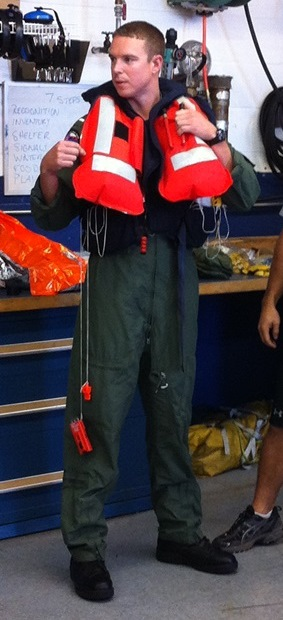 Inflated life preserver as used by US Coast Guard pilots. Note strobe light and whistle attached by lanyard.