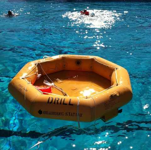 8-person raft inflated. While it supports a lot of weight, this kind of raft leaves the occupants exposed to wind and swell and is not trivial to board.