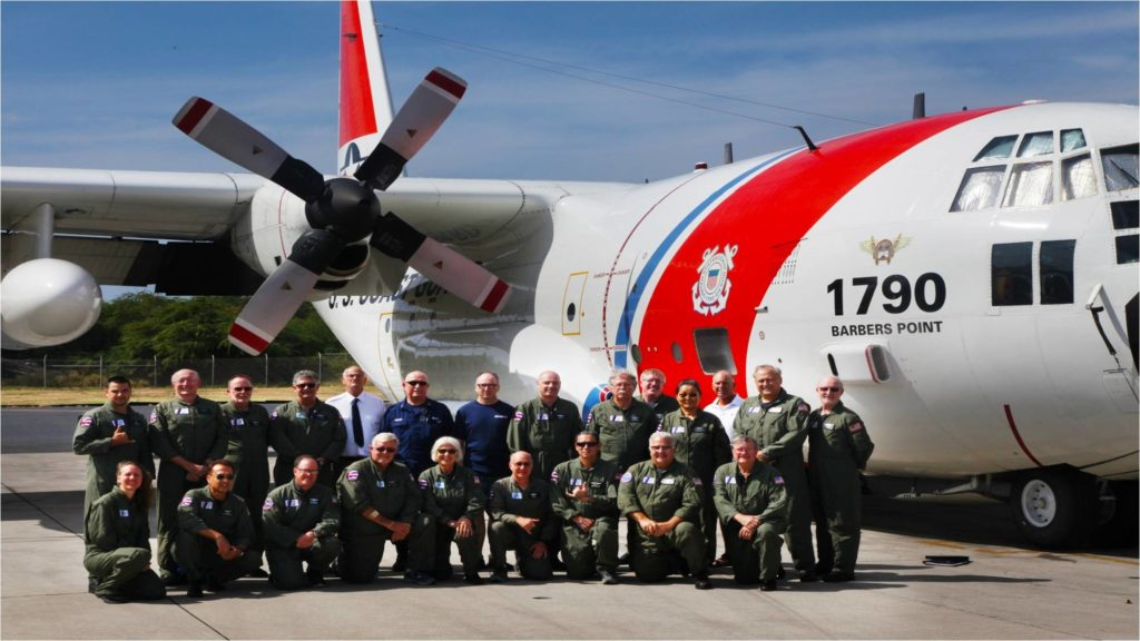 The Hawaii AUXAIR Squadron next to a  C130 aircraft.
